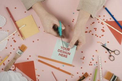 hands-cutting-card-with-your-design-logo